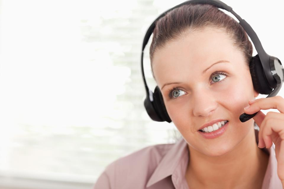 """""""An operator with headset helping someone"""" stock image"""