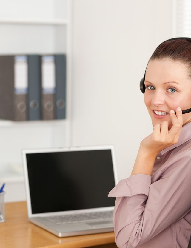 """""""Operator with headset in office"""" stock image"""