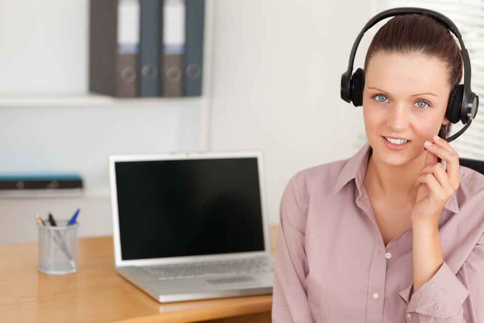"""""""Operator with headset by laptop"""" stock image"""
