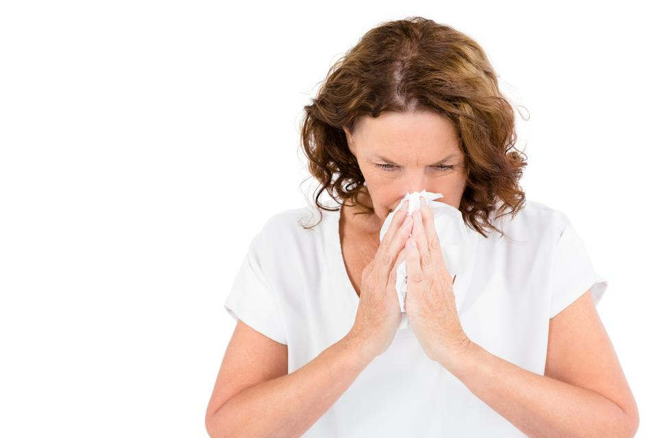 """Irritated mature woman sneezing"" stock image"