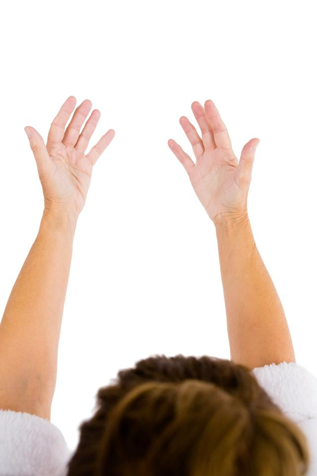 """""""Cropped image of woman with arms raised"""" stock image"""