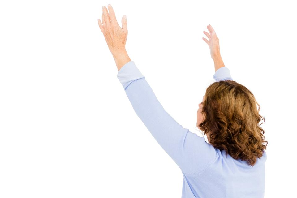 """""""Mature woman with arms raised while praying"""" stock image"""