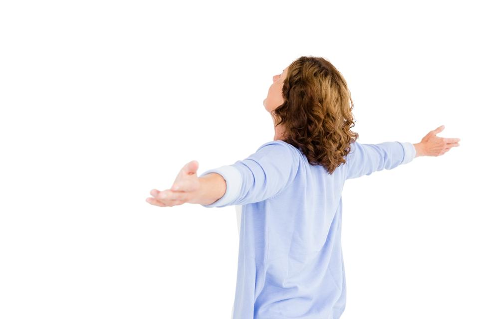 """""""Woman with arms outstretched while praying"""" stock image"""