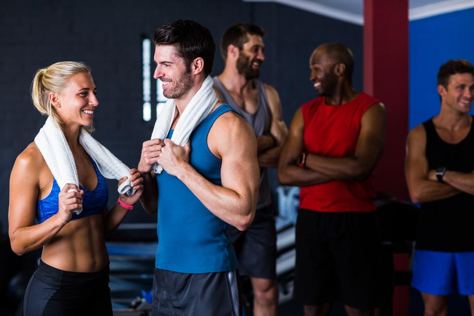 """Happy multi-ethnic friends in gym"" stock image"