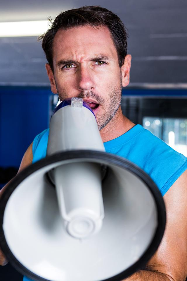 """Portrait of fitness instructor using megaphone"" stock image"