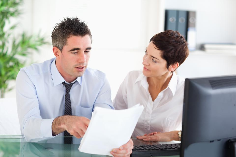 """""""Coworkers looking at a document"""" stock image"""