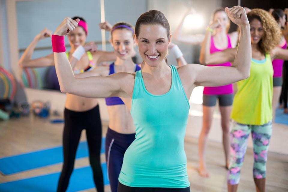 """""""Group of women showing biceps"""" stock image"""
