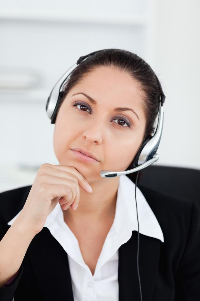 """""""Thoughtful operator looking into camera"""" stock image"""