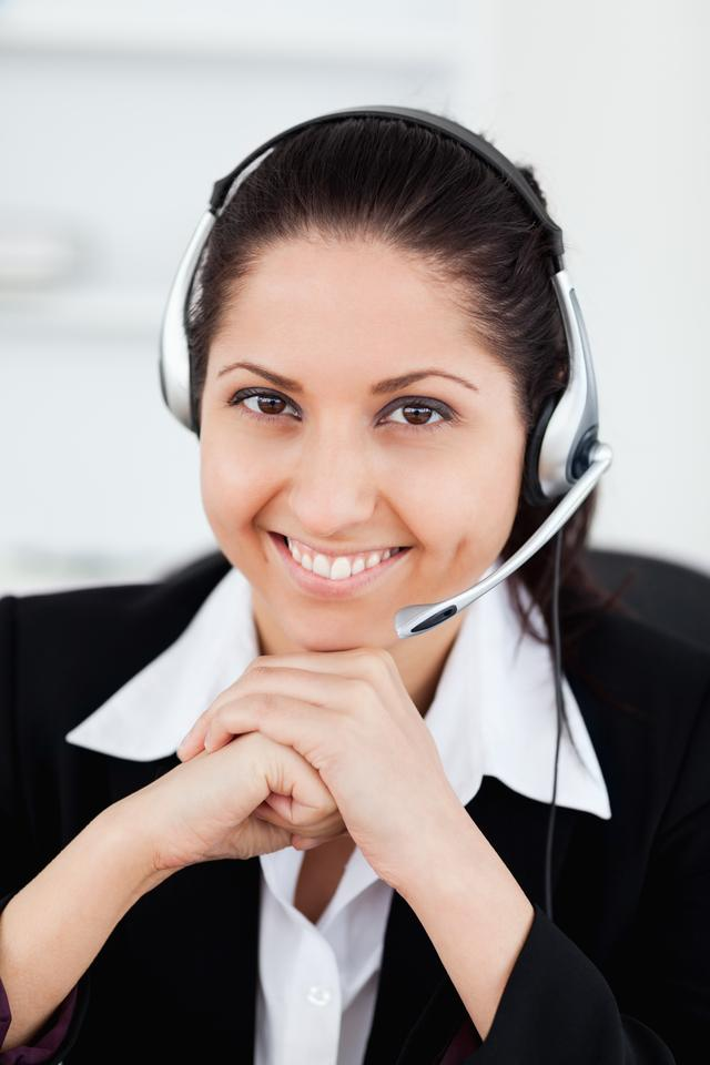 """""""Smiling operator in office"""" stock image"""