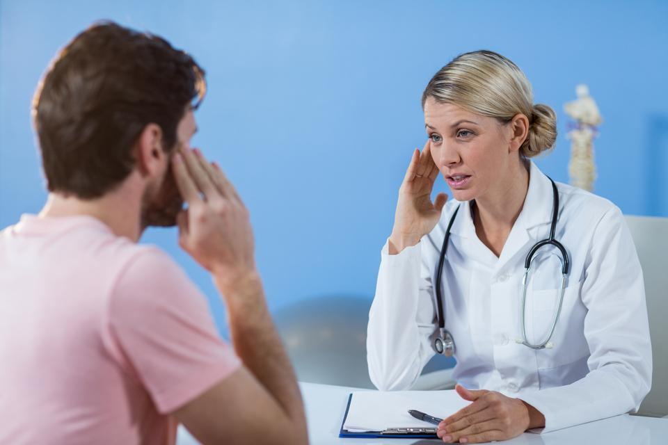 """""""Physiotherapist interacting with patient"""" stock image"""
