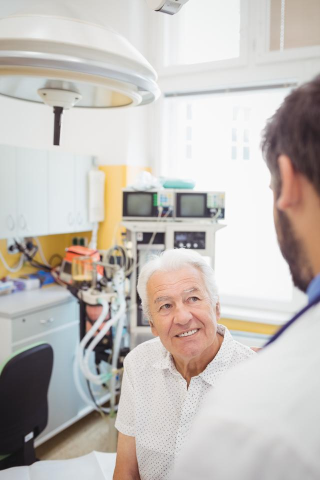 """""""Doctor interacting with patient"""" stock image"""