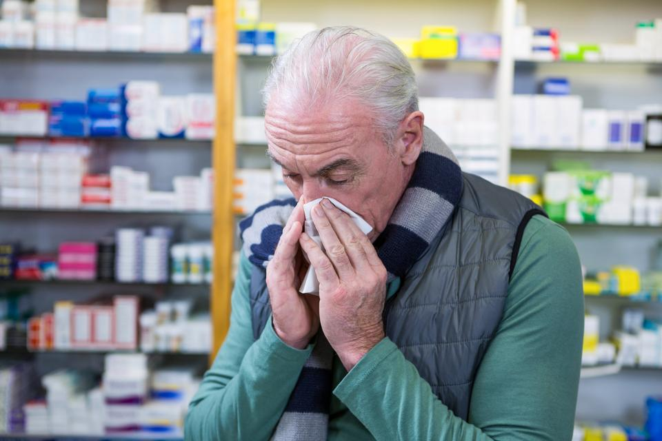 """""""Customer covering his nose with handkerchief while sneezing"""" stock image"""
