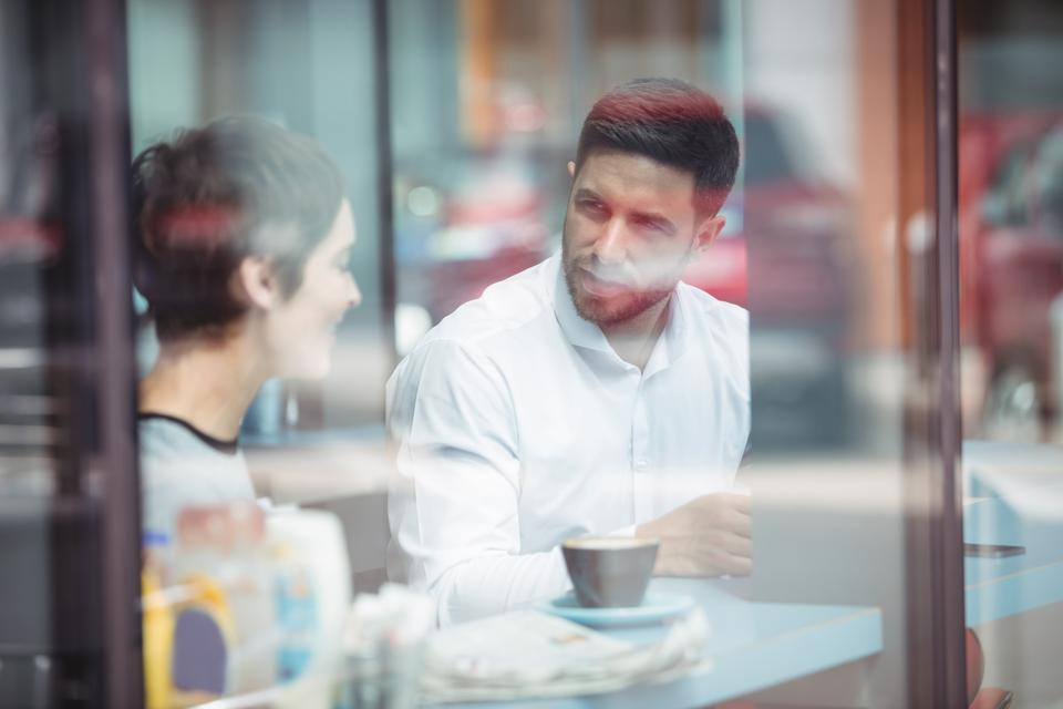 """""""Businesspeople interacting while having coffee"""" stock image"""