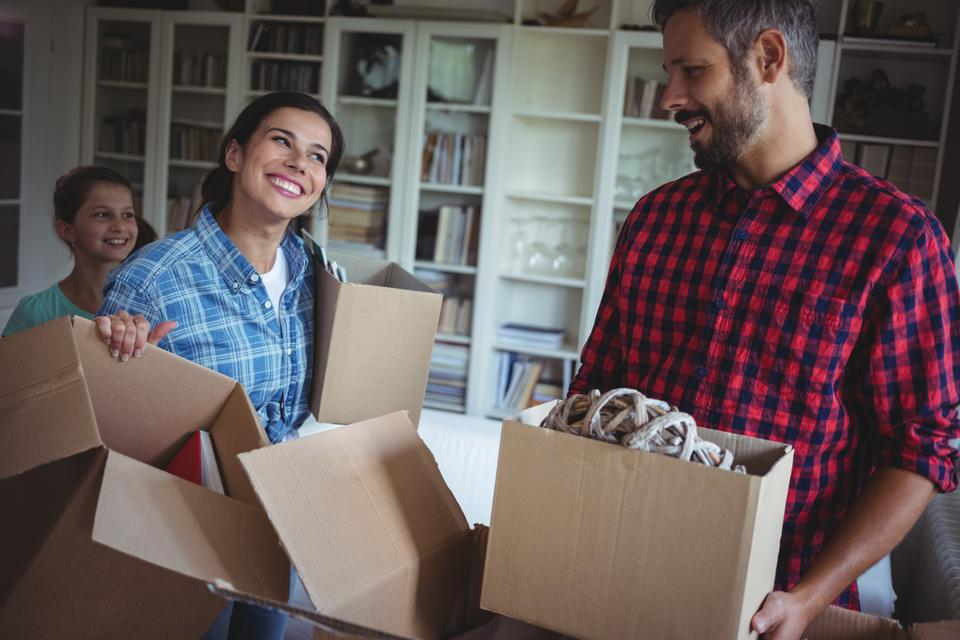 """""""Happy family unpacking cartons together"""" stock image"""