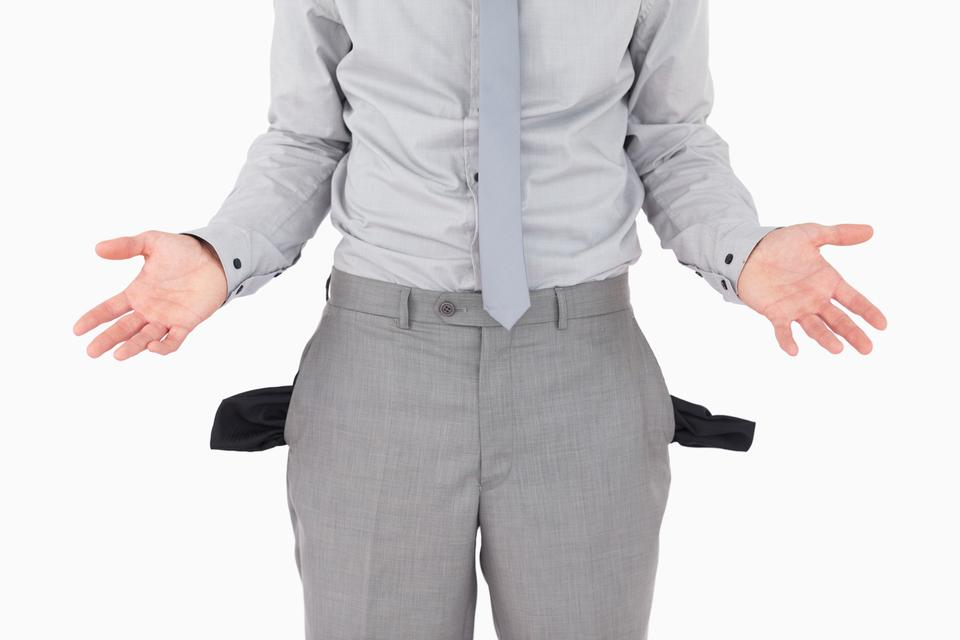 """Broke businessman with empty pockets"" stock image"