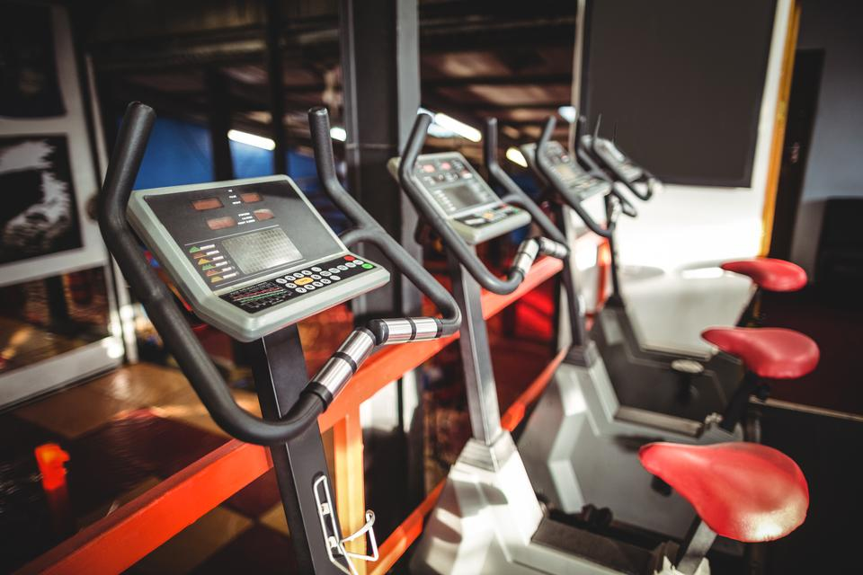 """""""Exercise bicycles in fitness studio"""" stock image"""