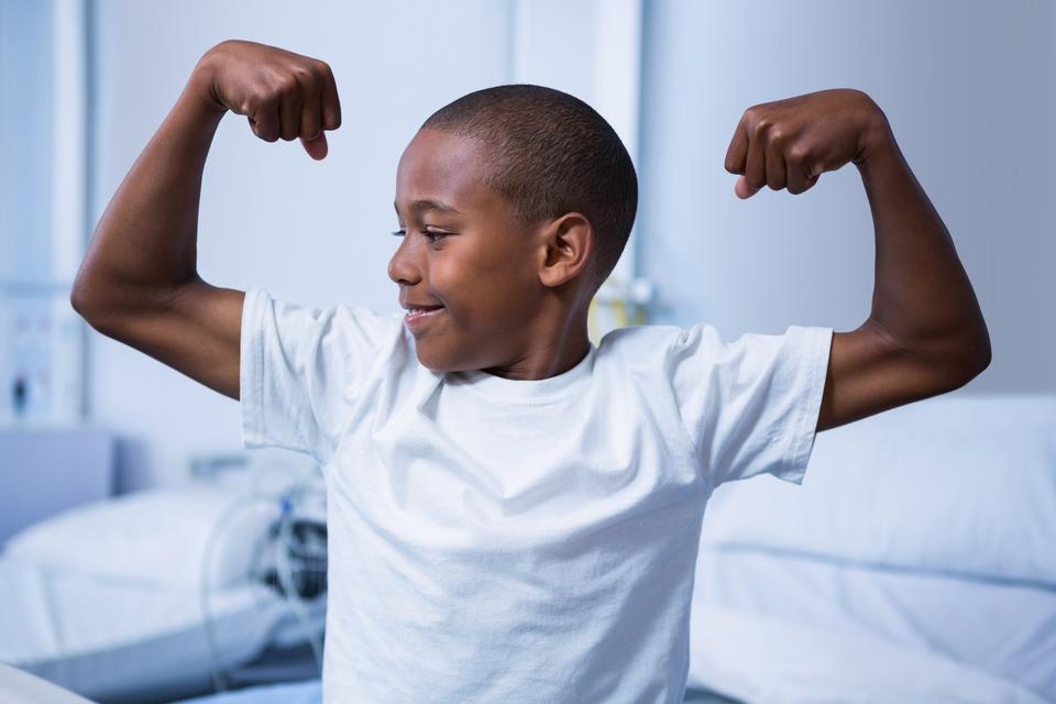 """""""Boy flexing his muscles in ward"""" stock image"""
