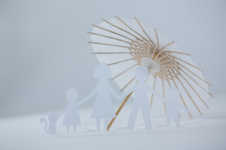 """""""Family paper cut-out figures with cocktail umbrella"""" stock image"""