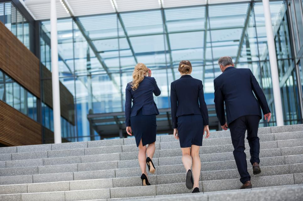 """Businesspeople climbing up the steps"" stock image"