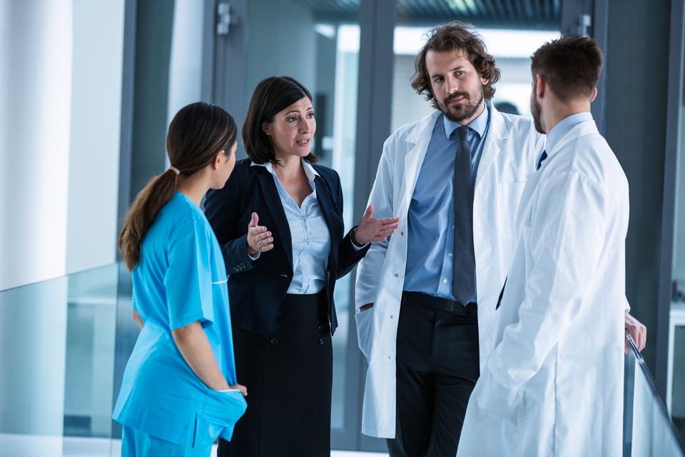"""""""Businesswoman interacting with doctors"""" stock image"""