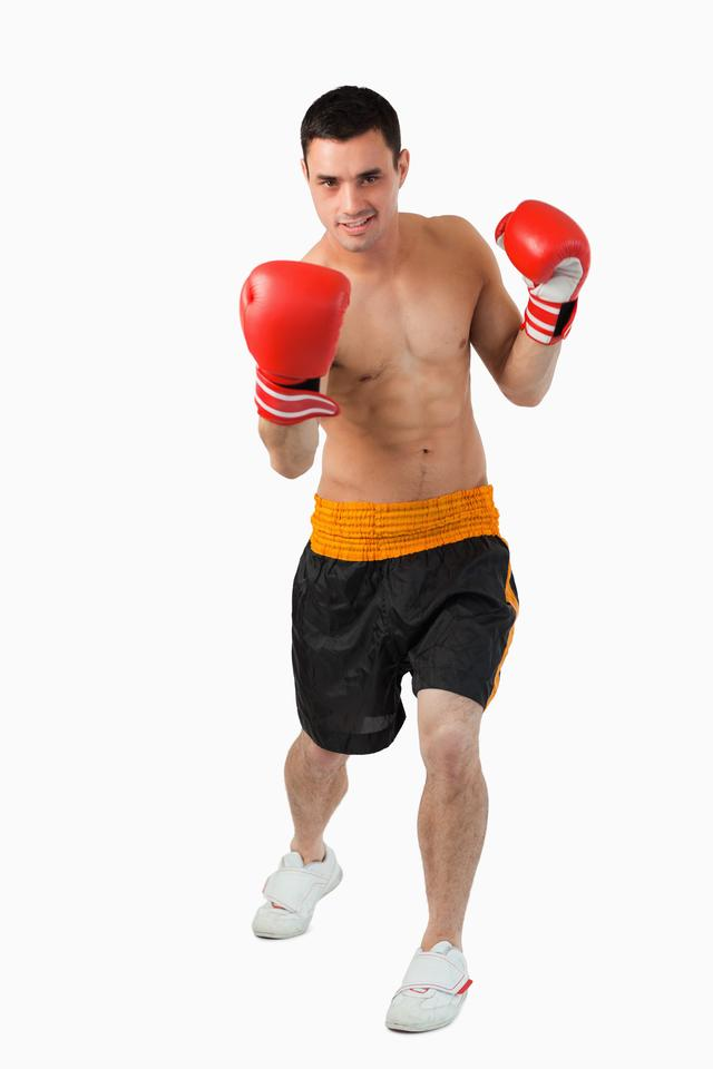 """""""Young boxer performing uppercut"""" stock image"""