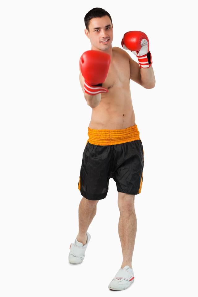 """""""Young male boxer performing uppercut"""" stock image"""