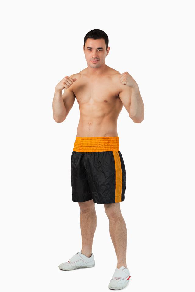 """""""Young boxer with bare fists up"""" stock image"""