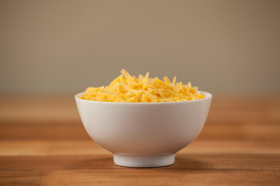 """""""Grated cheese in a bowl"""" stock image"""