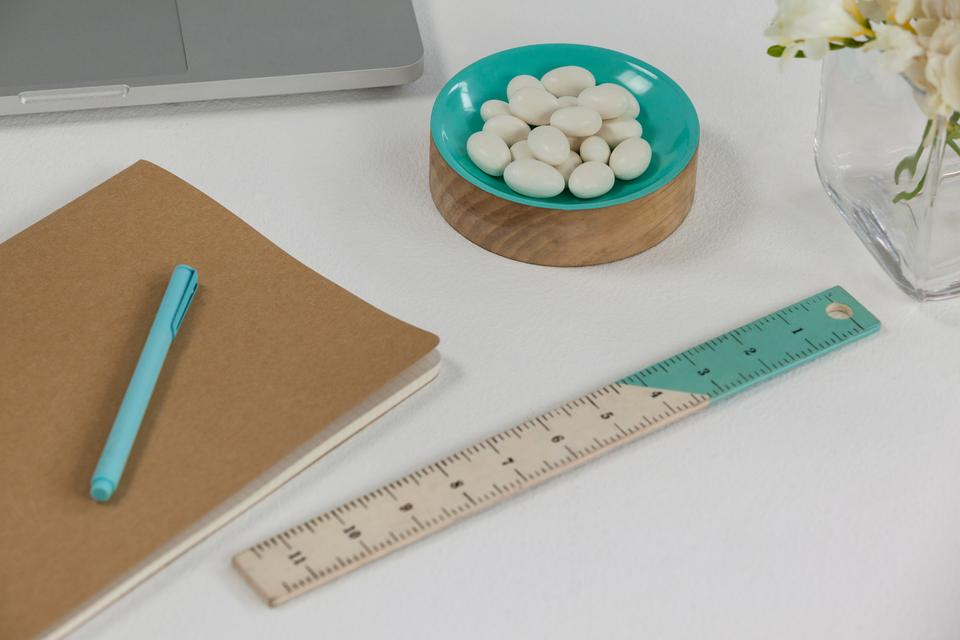 """Ruler, pen, pebbles, and diary"" stock image"