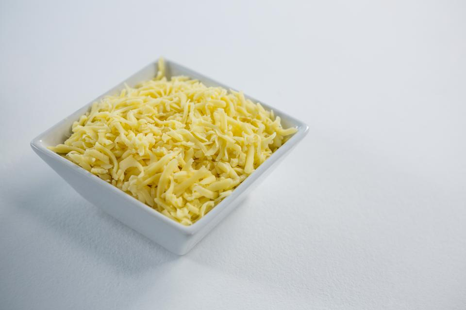 """""""Bowl of grated cheese"""" stock image"""