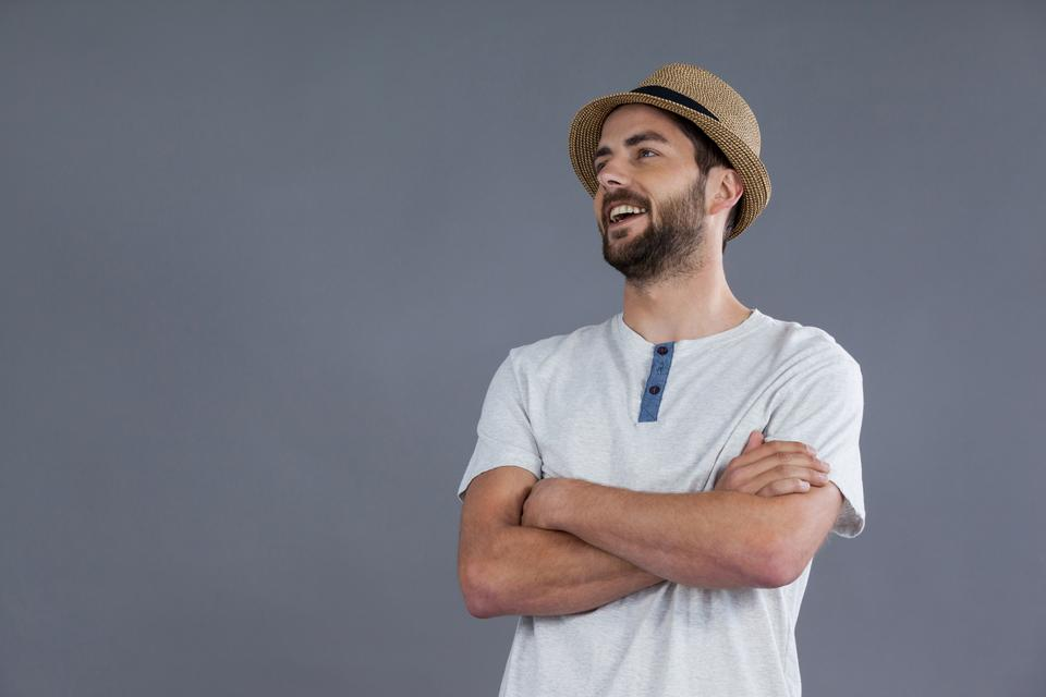 """""""Happy man in white t-shirt and fedora hat"""" stock image"""