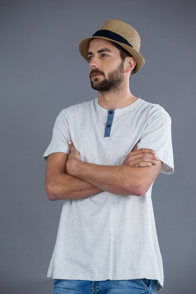 """""""Man in white t-shirt and fedora hat"""" stock image"""