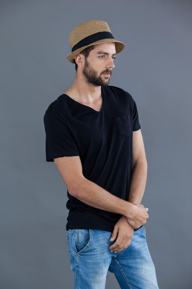 """""""Man in black t-shirt and fedora hat"""" stock image"""