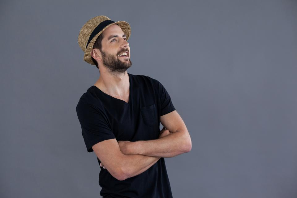 """""""Happy man in black t-shirt and fedora"""" stock image"""