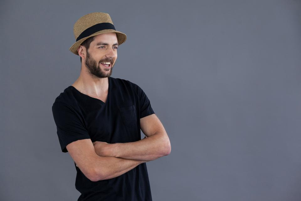 """""""Happy man in black t-shirt and fedora hat"""" stock image"""