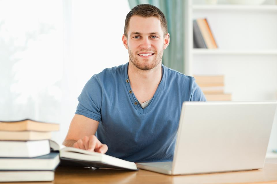 """""""Student happy about research results from the internet"""" stock image"""