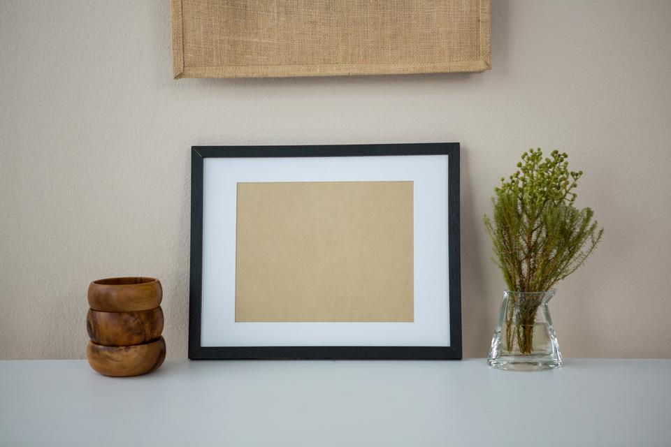 """""""Picture frame with wooden pencil holder and vase"""" stock image"""