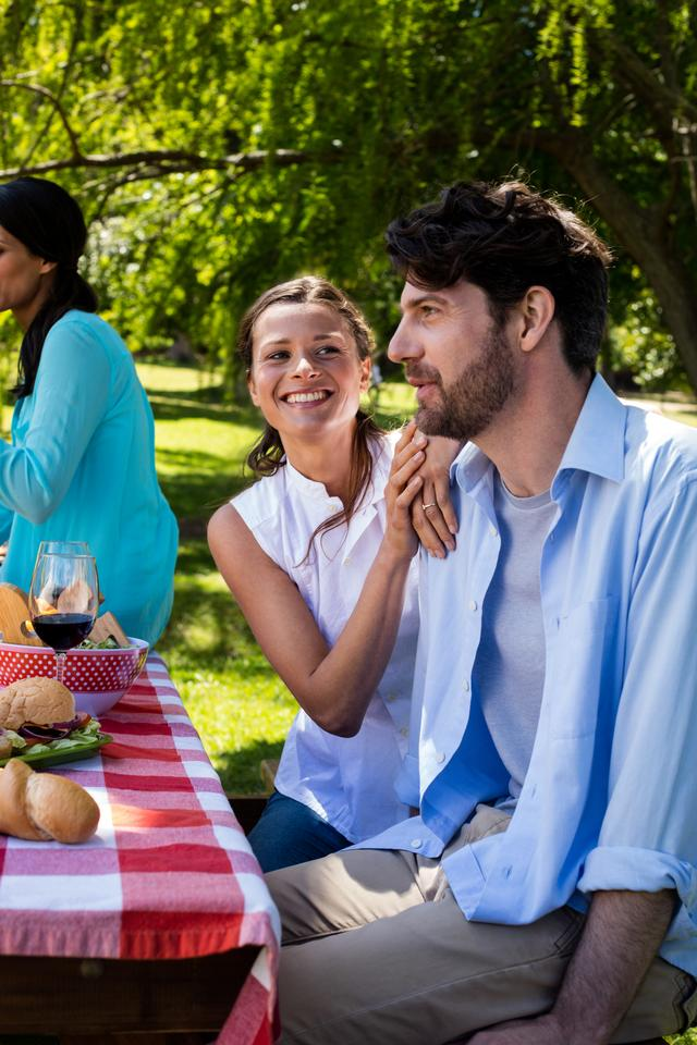 """""""Couple interacting in park"""" stock image"""