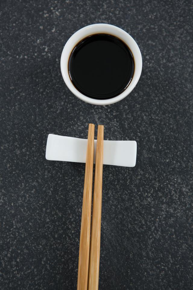"""Chopsticks and soy sauce on stone table"" stock image"