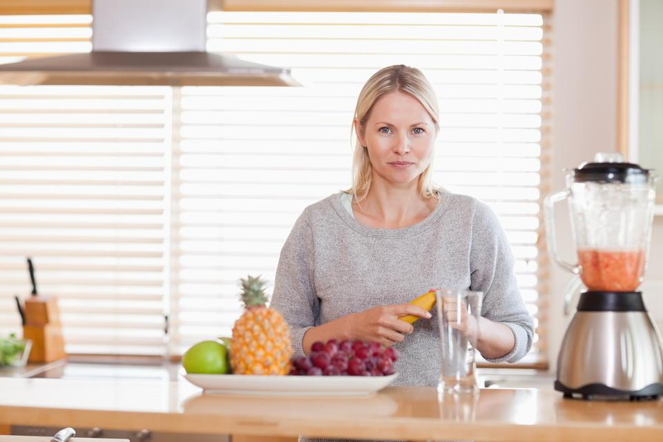 """Woman preparing fruits for the blender"" stock image"