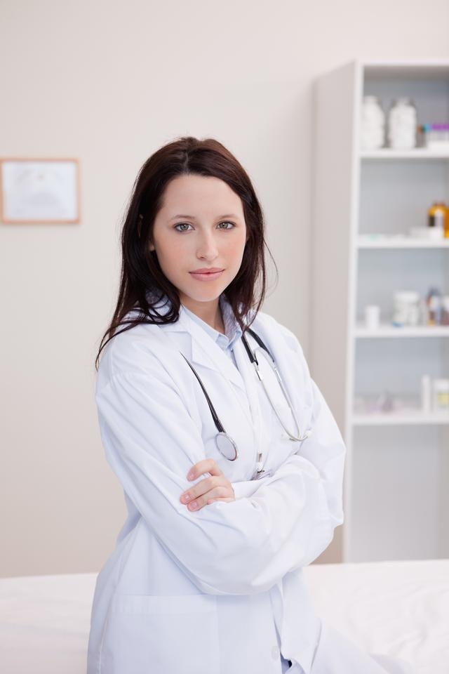 """Female physician with folded arms"" stock image"