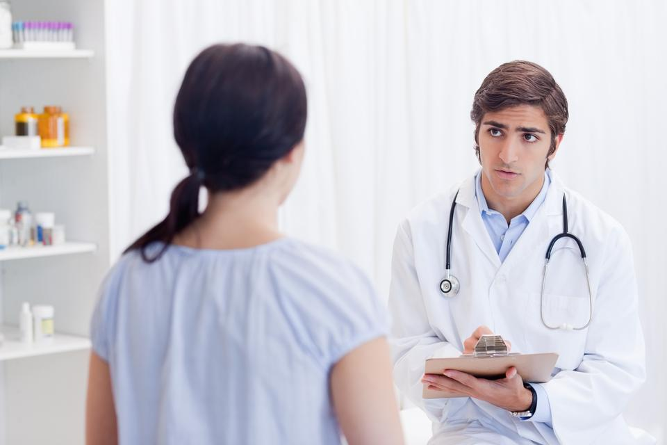 """Physician talking with patient"" stock image"