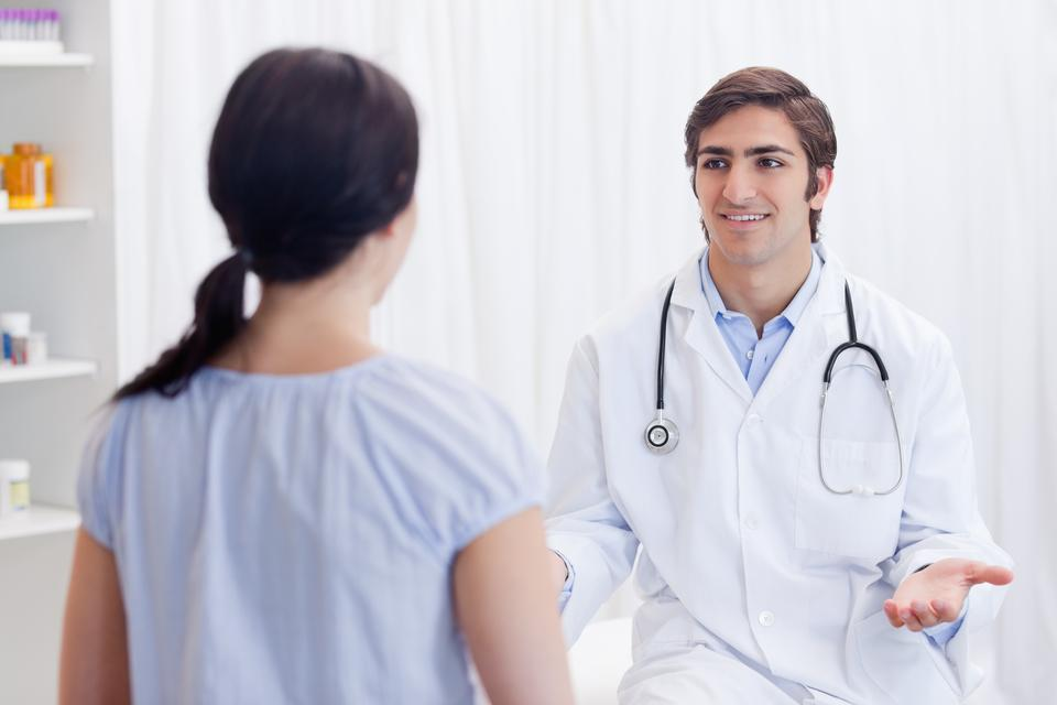 """Physician having a conversation with patient"" stock image"