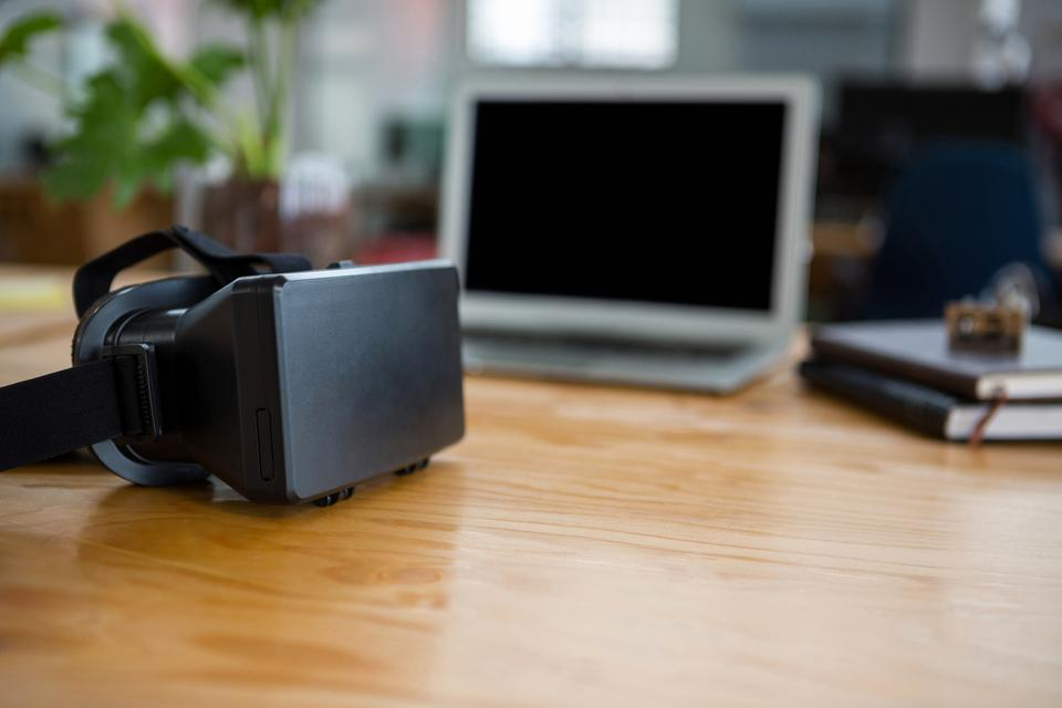 """Virtual reality headset on table"" stock image"