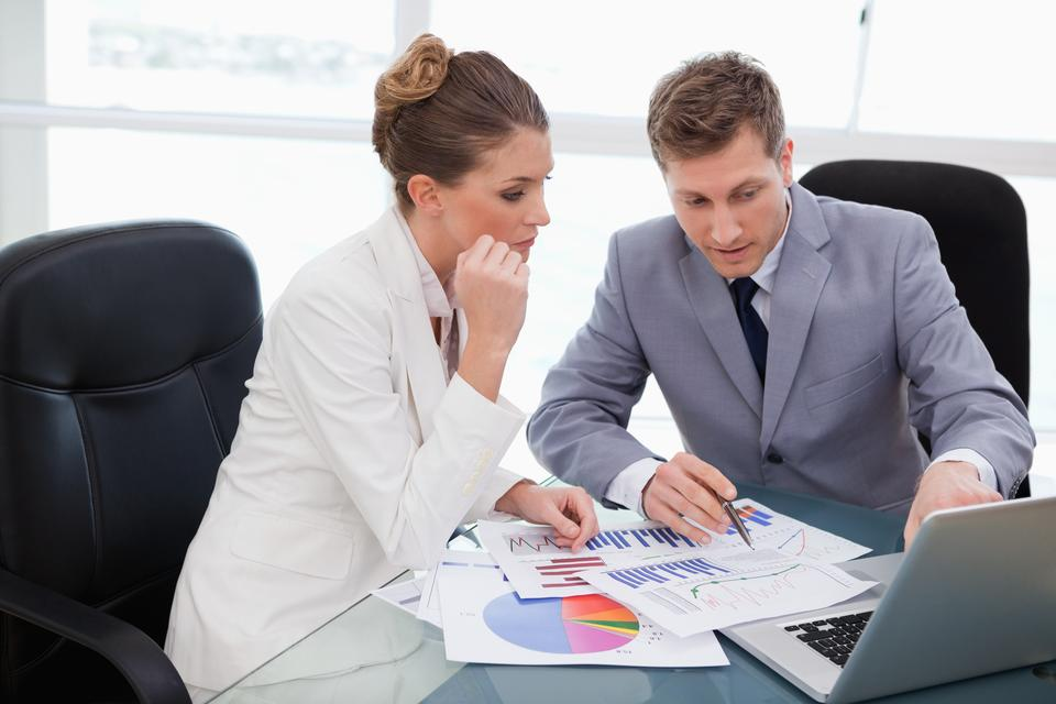 """Business team analyzing market research"" stock image"