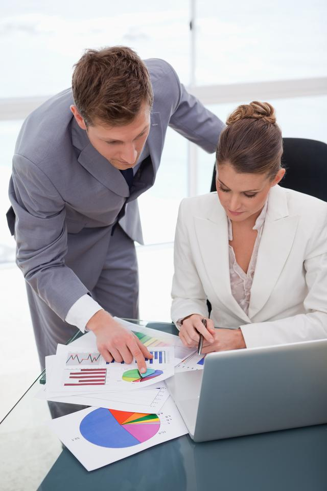 """Business team analyzing survey results"" stock image"
