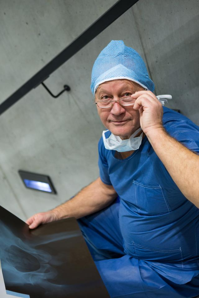 """""""Portrait of male surgeon examine x-ray on stairs"""" stock image"""