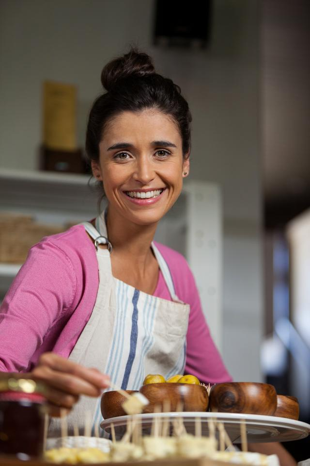 """Female staff working at counter in market"" stock image"