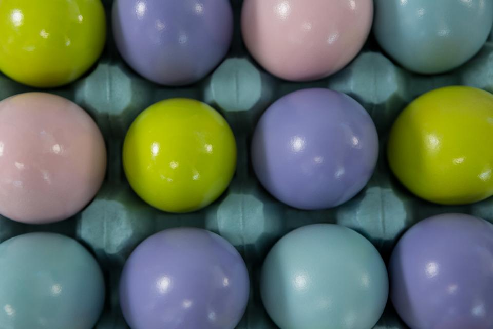 """Multicolored Easter eggs in the carton"" stock image"