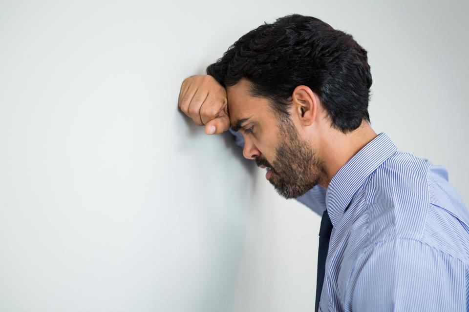 """""""Stressed businessman at conference centre"""" stock image"""